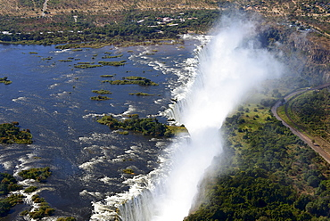 Aerial View, Zambezi river flows into the Victoria Falls, border of Zambia and Zimbabwe, Africa