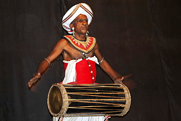 Drummer in traditional costume, Kandy, Central Province, Sri Lanka, Asia