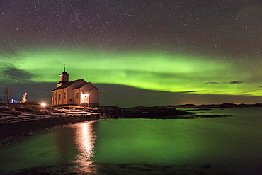 Church at the coast with northern lights, Gimsoy, Lofoten, Norway, Europe