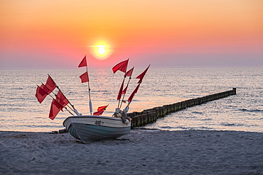 Fishing boat on the beach at sunset, Ahrenshoop, Mecklenburg-Western Pomerania, Germany, Europe