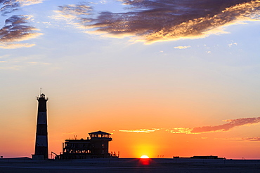 Silhouettes, Lighthouse and Lodge at sunset, Pelican Point, Walvis Bay, Erongo region, Namibia, Africa