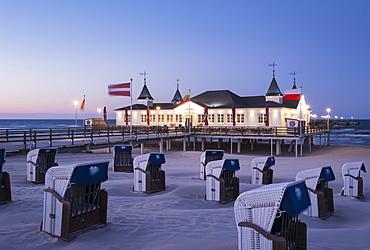Beach chairs, Ahlbeck seaside resort pier at dusk, Ahlbeck, Heringsdorf, Usedom, Baltic Sea, Mecklenburg-Western Pomerania, Germany, Europe