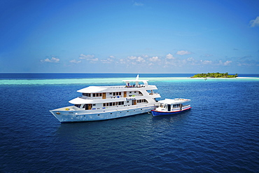 Diving safari ship MS Keana with diving dhoni anchored off an uninhabited palm island, Ari Atoll, Indian Ocean, Maldives, Asia