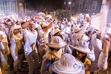 Crowd of people, white powder and white clothes, evening mood, carnival La Fiesta de los Indianos, Las Palmas de Gran Canaria, Canary Islands, Spain, Europe