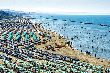 Overcrowded touristic bathing beach with umbrellas, Lungomare Cristoforo Colombo, Molise, Italy, Europe
