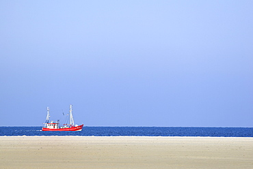 Red fishing boat in the North Sea, St. Peter-Ording Beach, Schleswig-Holstein Wadden Sea National Park, North Frisia, Schleswig-Holstein, Germany, Europe