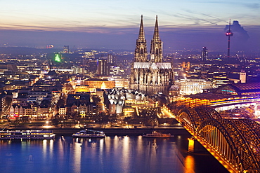 Cityscape with Cologne Cathedral, Hohenzollern Bridge and the Rhine at dusk, Cologne, Rhineland, North Rhine-Westphalia, Germany, Europe