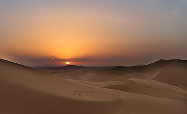 Sunset on the dunes of Tanamoust, Sahara, Morocco, Africa