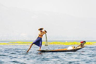Local fishermen leg rowing on wooden boat, Inle Lake, Shan State, Myanmar, Asia