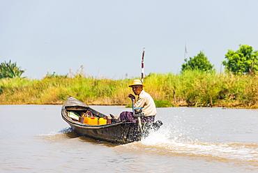Local man steers motorboat, Inle Lake, Shan State, Myanmar, Asia