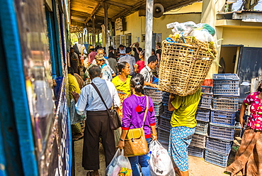 Locals boarding train on platform, Yangon Circular Railway, Yangon, Myanmar, Asia
