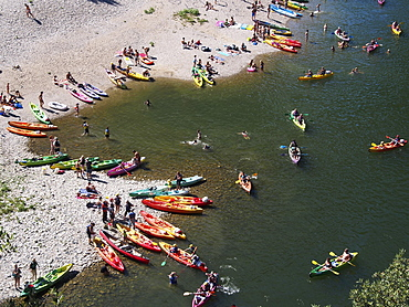 Boats on the beach on the Ardeche river, near Vallon-Pont-d'Arc, Ardeche, Rhone-Alpes, France, Europe