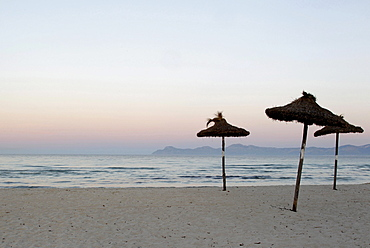Parasols on the beach in the early morning, Alcudia, Majorca, Balearic Islands, Spain, Europe
