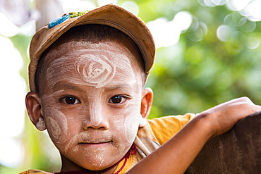 Child with Thanaka paste in the face of mountain tribe or mountain people Pa-O or Pa-Oh or Pao or Black Karen or Taungthu or dew-soo, ethnic minority, portrait, near Kalaw, Shan State, Myanmar, Myanmar, Asia