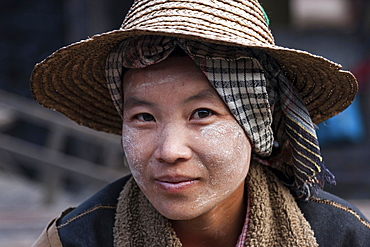Native Woman with typical hat and Thanaka paste on the face, portrait, Nyaung Shwe, Shan State, Myanmar, Asia
