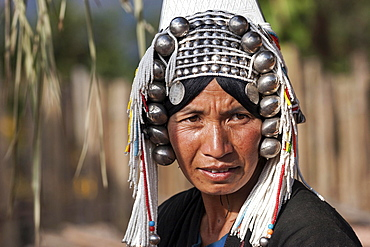 Old local woman from the tribe of the Akha with typical headdress, portrait, Hokyin Akha Village, near Kyaing Tong, Shan State, Golden Triangle, Myanmar, Asia