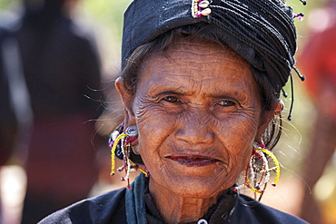 Native woman in typical clothing and headgear from the Ann tribe in a mountain village at Pin Tauk, portrait, Shan State Golden Triangle, Myanmar, Asia
