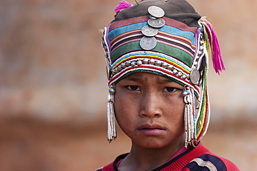 Girl of the Akha ethnic group with traditional headdress, portrait, near Kyaing Tong, Myanmar, Asia
