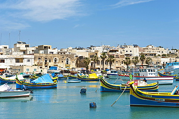 Colorfully painted traditional fishing boats, Luzzu, harbour of Marsaxlokk, Malta, Europe