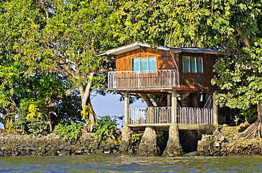 Wooden house on a small island with tropical vegetation in Lake Nicaragua, Isletas, Lago de Nicaragua, Nicaragua, Central America