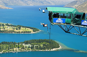 Bungee-jump, platform with jumper over the city of Queenstown, New Zealand, Oceania