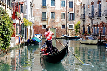 Gondola with gondolier using cell phone, Dorsoduro, Venice, Veneto, Italy, Europe