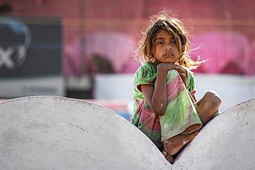 Girl sitting on a wall, portrait, Pushkar, Rajasthan, India, Asia
