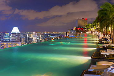 Downtown central financial district at night viewed from the Infinity pool of the Marina Bay Sands, Singapore, Asia