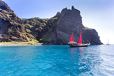 Sailing ship with red sails in a small bay near Los Gigantes, Santiago del Teide, Tenerife, Canary Islands, Spain, Europe