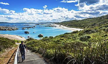 Woman walking down to Greens Pool in William Bay National Park, Western Australia, Australia, Oceania