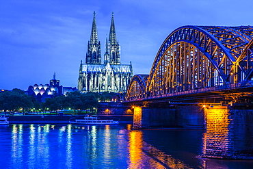 Hohenzollern Bridge and Cologne Cathedral on the Rhine at night, Cologne, Germany, Europe