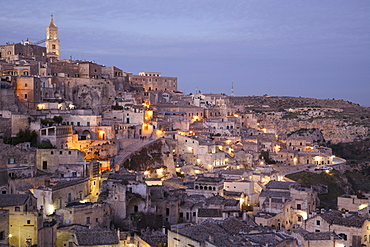 View across the town from the viewpoint at Piazzetta Pascoli, dusk, Sassi di Matera, cave dwellings, Matera, Basilicata, Italy, Europe