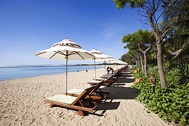 Beach with sun beds of the Saigon Ninh Chu Resort on the beach of Phan Rang, Ninh Thuan, Vietnam, Asia