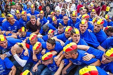 Crowd with the Belgian flag as a mask on their heads, Doudou city festival in Grand Place square, Mons, Belgium, Europe