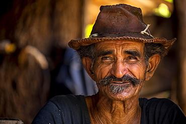 Sugar cane farmer wearing a hat, portrait, Valle de los Ingenios, Trinidad, Sancti Spiritus Province, Cuba, Central America
