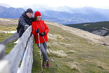 Man and woman, couple during Nordic Walking in the mountains, Rittner Horn, South Tyrol, Italy, Europe