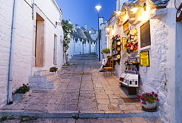 Dusk, shop, trulli traditional round houses, Rione Monti, Alberobello, Valle d'Itria, Trulli Valley, Apulia, Italy, Europe