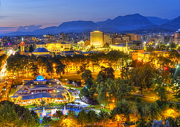 Rinia-Park and city centre, view from Sky Tower, back surroundings with mountains, dusk, Tirana, Albania, Europe