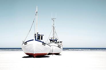 Fishing boats lying in the sand, on the beach, Jutland, Denmark, Europe