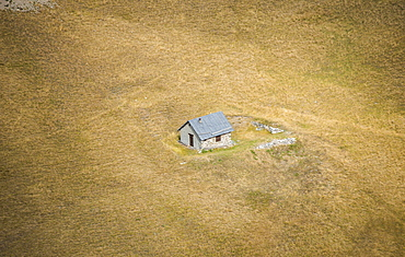 An isolated house, alone in the fields, from the Col du Galibier, Savoie, France, Europe