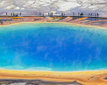 Tourists standing on the edge of Grand Prismatic Spring, Yellowstone National Park, Wyoming, United States, North America