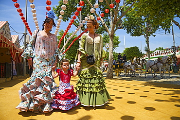 Flamenco dancers and little girl at the Feria de Abril, Seville, Andalucia, Spain, Europe