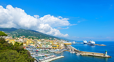 Overview of the old town, the old harbor and the new ferry terminal with the church of Saint-Jean-Baptiste, Bastia, Corsica, France, Europe