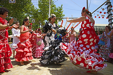 Flamenco dancers at the Feria de Abril, Seville, Andalucia, Spain, Europe