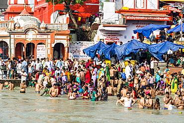 Masses of pilgrims are gathering for bathing at Harki Pauri Ghat at the holy river Ganges, Haridwar, Uttarakhand, India, Asia