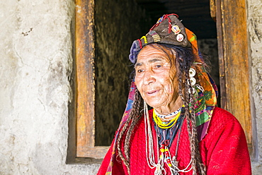 A woman of the Brokpa tribe, wearing her traditional dress with the typical flower headdress, Dah Hanu, Jammu and Kashmir, India, Asia