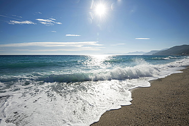 Waves on the beach with the sun, Varigotti, Finale Ligure, Riviera di Ponente, Liguria, Italy, Europe