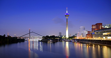 Rhine tower, Gehry Buildings, Neuer Zollhof, media harbor, dusk, blue hour, Dusseldorf, North Rhine-Westphalia, Germany, Europe