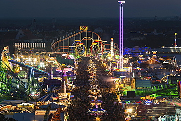Rides on the fairground road with Olympia Looping, Funferlooping roller coaster at night, Oktoberfest, Theresienwiese, Munich, Upper Bavaria, Bavaria, Germany, Europe