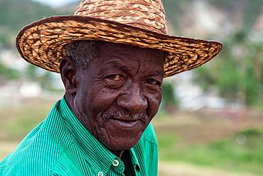 Cuban man wearing a straw hat, portrait, near Santiago de Cuba, Cuba, Central America